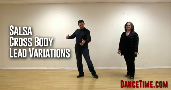 couple teaching a salsa cross body lead